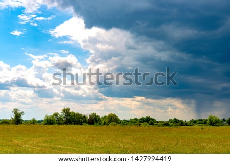 Background of thunderstorm clouds before a thunderstorm in the countryside #1427994419