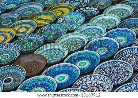 Background of traditional Uzbek ceramic plates - stock photo