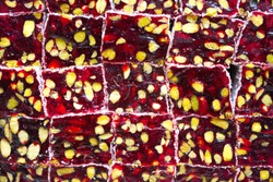 Background of Turkish delight. a pile of Turkish delicacies with pomegranate and pistachios.