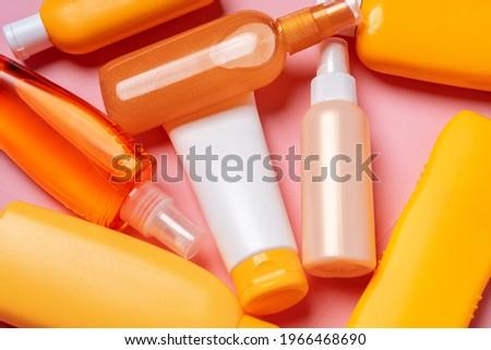 Background of variety of suntan skincare product bottles Stock photo ©