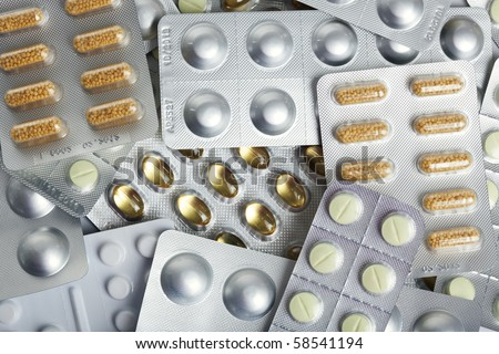 background of various blister packs with pills and capsules