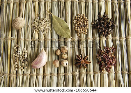 background of various spices on mat