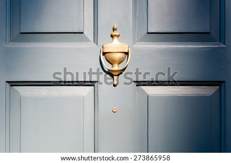 Background of vintage blue painted door and knocker vignette look - Shutterstock ID 273865958