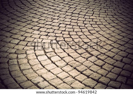Background of  vintage street with cobblestone in circular pattern