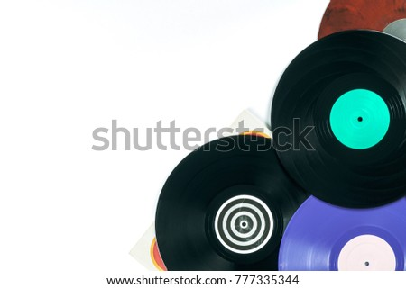 Background of vinyl records DJs for a music player on a white background close-up. Red, black, white vinyl records. Retro audio equipment for disc jockey. Sound technology for DJ to mix & play music