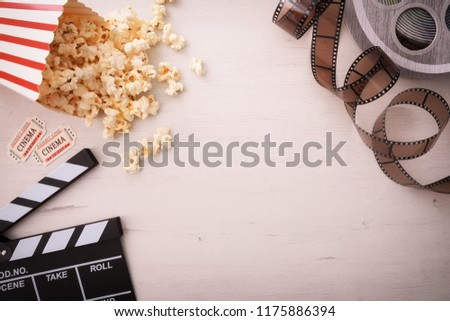 Background of watching movies with several objects with a wooden background. Horizontal composition. Top view.