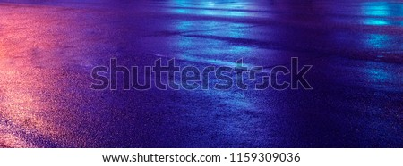 Background of wet asphalt with neon light. Blurred background, night lights, reflection.