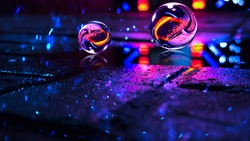 Background of wet asphalt with neon light. Reflection of neon lights in puddles, bright colors, glass ball. Neon night city