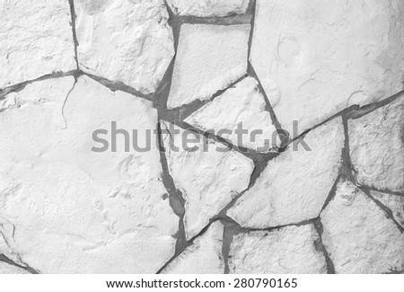 Background of white broken stone wall texture