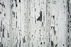 Background of white, peeling paint on an old wall