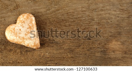 background of wooden desk and single cookie of love