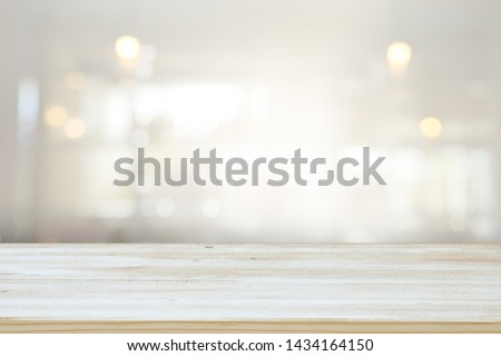 background of wooden table in front of abstract blurred window light