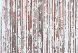 Background of wooden wall with peeling white paint