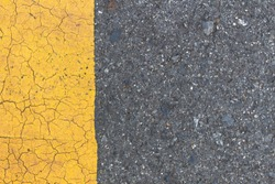 Background of yellow black strips . Dark grey asphalt road divided by yellow paint. yellow black background