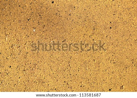 Background of yellow stone wall texture pattern - stock photo