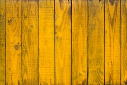 Background of yellow wood texture for design pattern artwork.