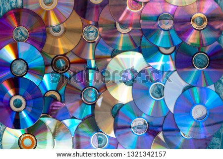 Background on the wall with old damaged discs cd. #1321342157