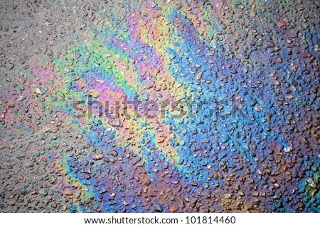 Background or texture of an oil spill on asphalt road