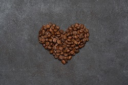 Background or wallpapper - heart made of coffee beans on congrete