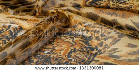 background pattern African fabric with silk print with tiger print. This amazing fabric will help you to plunge into the world of unbridled savannah. You will be sensual with design projects #1331300081