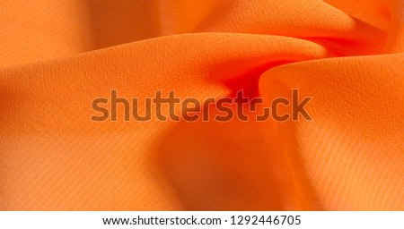 background, pattern, texture, Orange silk fabric has a brilliant luster. It folds into soft folds when draping and is the most versatile fabric. Be creative with beautiful accents of your design.
