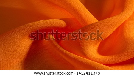 background, pattern, texture, Orange silk fabric has a brilliant luster. It folds into soft folds when draping and is the most versatile fabric. Be creative with beautiful accents of your design. #1412411378