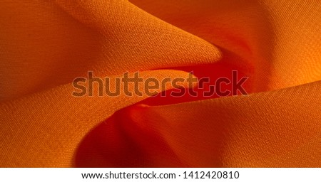 background, pattern, texture, Orange silk fabric has a brilliant luster. It folds into soft folds when draping and is the most versatile fabric. Be creative with beautiful accents of your design. #1412420810
