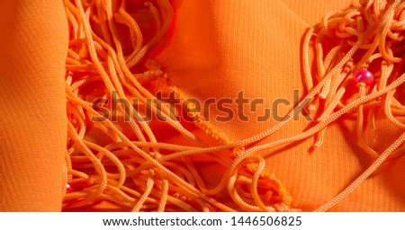 background, pattern, texture, Orange silk fabric has a brilliant luster. It folds into soft folds when draping and is the most versatile fabric. #1446506825