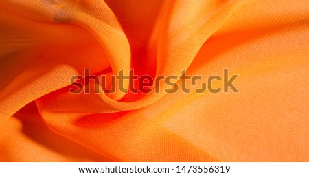 background, pattern, texture, Orange silk fabric has a brilliant luster. It folds into soft folds when draping and is the most versatile fabric. #1473556319