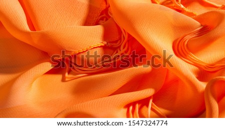 background, pattern, texture, Orange silk fabric has a brilliant luster. It folds into soft folds when draping and is the most versatile fabric. Be creative with beautiful accents of your design. #1547324774