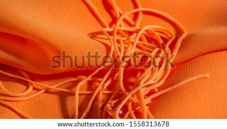 background, pattern, texture, Orange silk fabric has a brilliant luster. It folds into soft folds when draping and is the most versatile fabric. Be creative with beautiful accents of your design. #1558313678