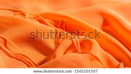 background, pattern, texture, Orange silk fabric has a brilliant luster. It folds into soft folds when draping and is the most versatile fabric. Be creative with beautiful accents of your design. #1565101507