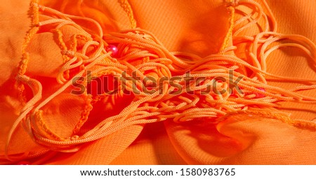 background, pattern, texture, Orange silk fabric has a brilliant luster. It folds into soft folds when draping and is the most versatile fabric.  #1580983765