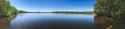background photo panorama, view of a beautiful forest lake designed for fishing, in the midst of lush greenery, in the territory of a natural national park, in Mari El, Russia