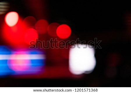 Background photography of some defocused night lights creating bokeh effect. #1201571368