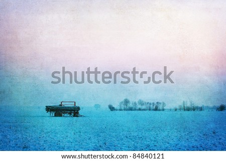 background picture of wintry agricultural landscape with grunge texture