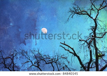 background picture with skeletal trees with snow on their branches against the night sky with moon and watercolor paper for texture