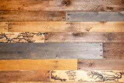 Background - repurposed wood planks- a few have unusual fractal lightning high voltage lichtenberg wood burning patterns