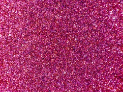 Background sequin. PINK sparkle background. Holiday abstract glitter background with blinking lights. Fabric sequins in bright colors. Fashion fabric glitter, sequins.