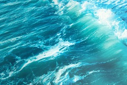 Background shot of clear sea water surface texture tidewater green color. natural texture