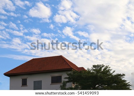 Background sky with houses on the bottom of the image picture big, home roof and tree, landscape property village on blue sky