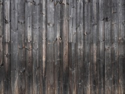 background snap shot ; dark old pine wood wall, wooden pattern on building wall. vintage texture concept on photography image.
