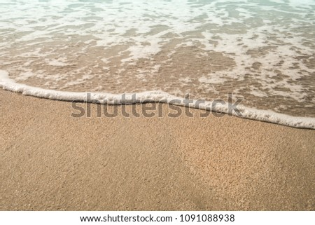 Background soft wave of Sea with foam on sandy beach, copy space. #1091088938