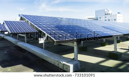 background, solar panel put on the rooftop in the city.