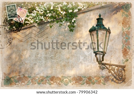 Background, stylized as vintage postcard, with street lamp and white lilacs. There's space for your text.