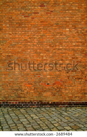background texture brick wall and cobbled road