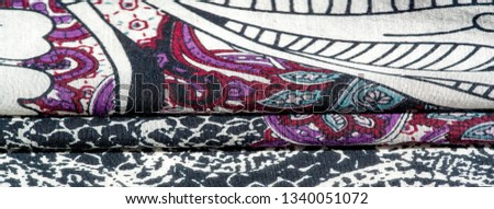 Background texture. cotton women scarf black and white pattern on one side of the scarf and color paisley pattern on the other side #1340051072