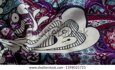 Background texture. cotton women scarf black and white pattern on one side of the scarf and color paisley pattern on the other side #1398025721