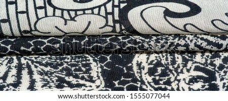 Background texture. cotton women scarf black and white pattern on one side of the scarf and color paisley pattern on the other side #1555077044