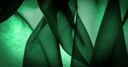 Background texture Dark green chiffon silk is a soft transparent fabric with a slight roughness (matte, creped) due to the use of twisted yarn.